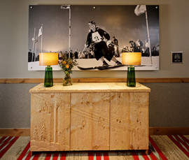 Elevator lobby hand carved chest w/ mural photograph by Dick Durrance