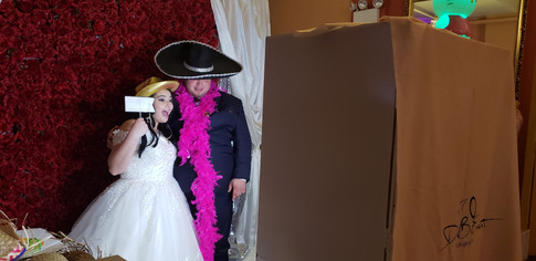 Bride and Groom Using Photo Booth