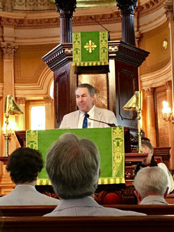 Palmetto Society Chairman Charles Warring III in the pulpit follow by gathering in George Washington