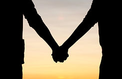 Two people holding hands peer support