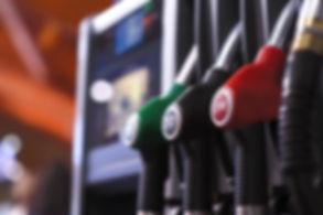 petrol-gas-pump-nozzles-at-a-service-sta