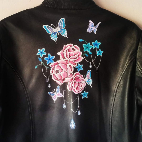 Butterfly hand painted design on leather