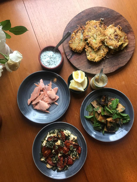 Potato and leek pancakes, smoked trout, tomatoes with mint and mozzarella, marinated zucchini.