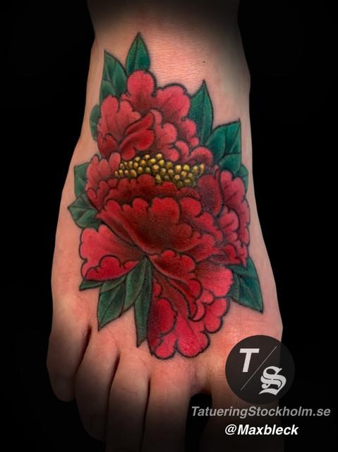 Flower peony foot tattoo
