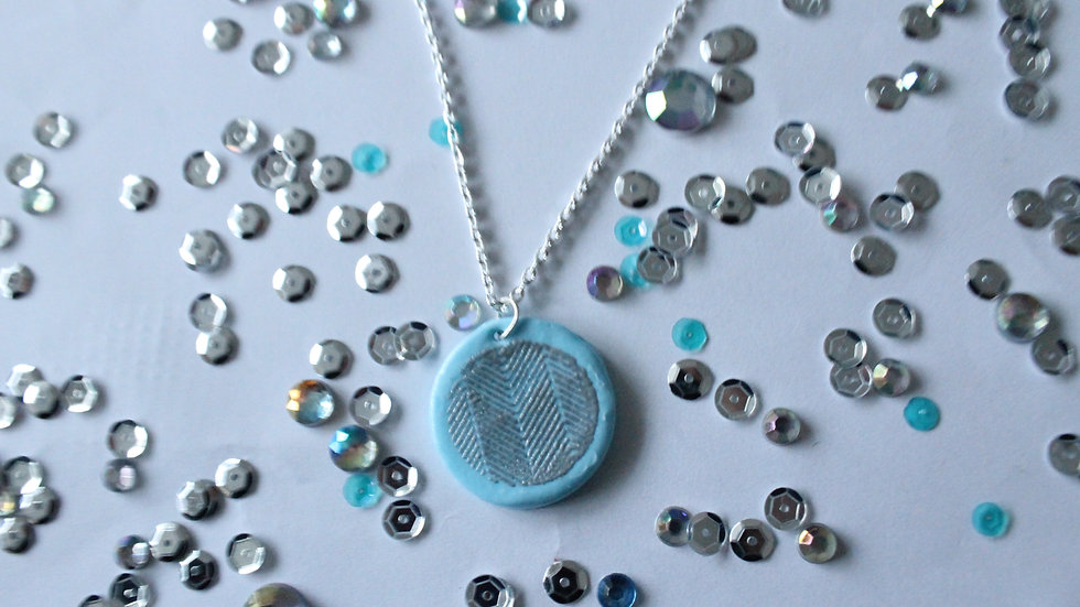 Light Blue Round Necklace with Silver Embossed Line Print