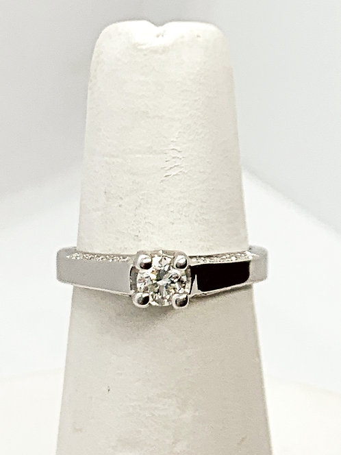 WG Solitaire with side mount Diamonds on band Engagement Ring