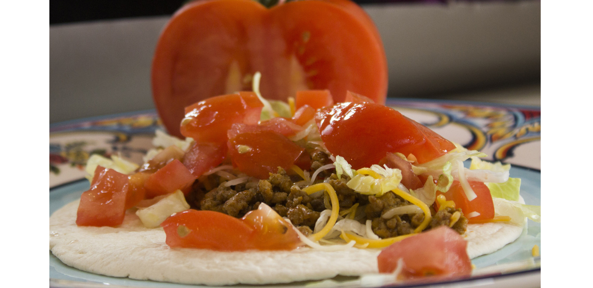 Taco with tomato background (Spanish Chef Project)