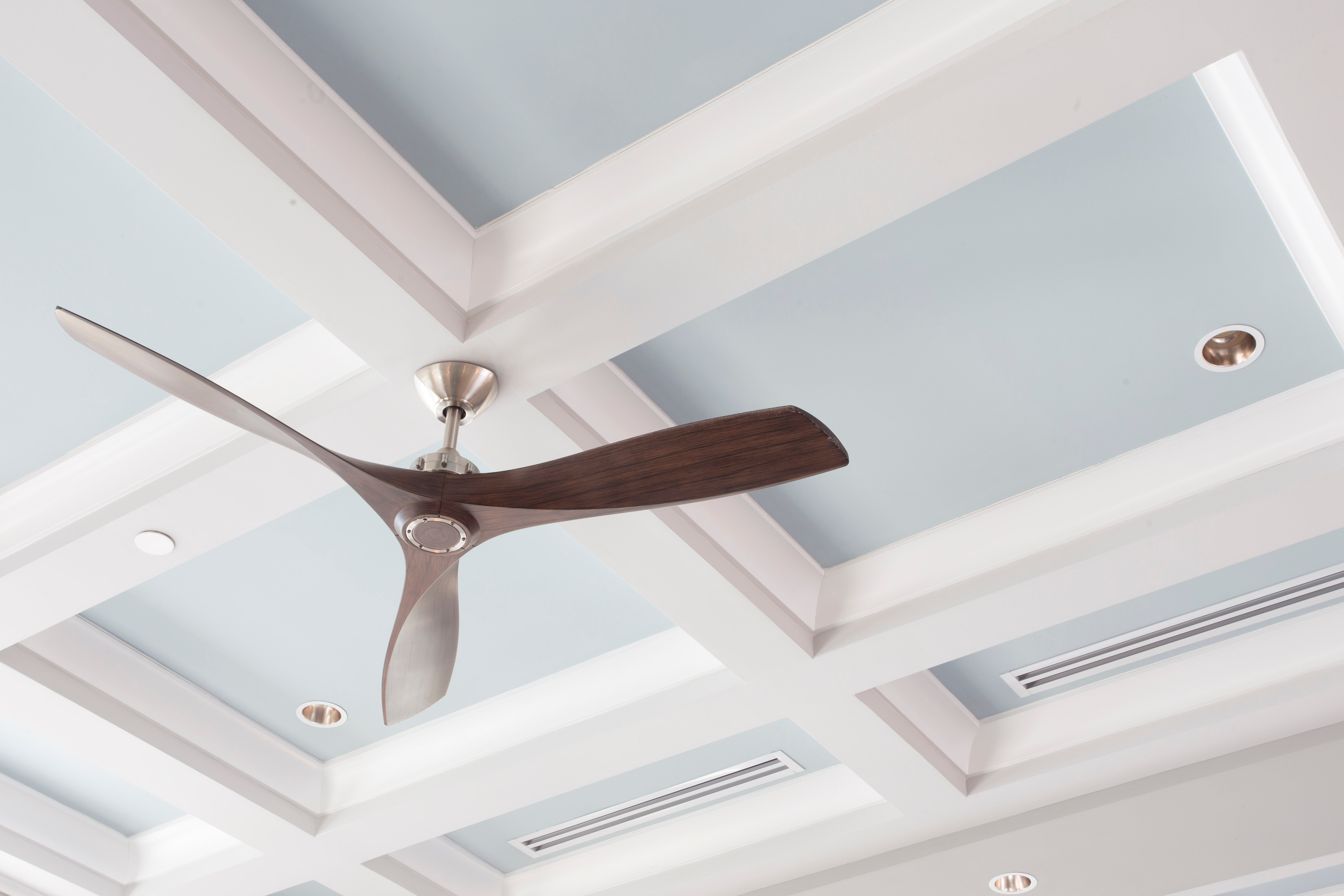 A Large Interior Fan on a Blue Coffered
