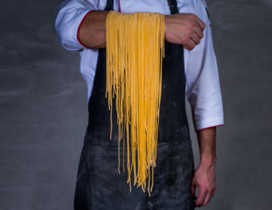Dubai travel guide: man holding spaghetti, The Oberoi Dubai