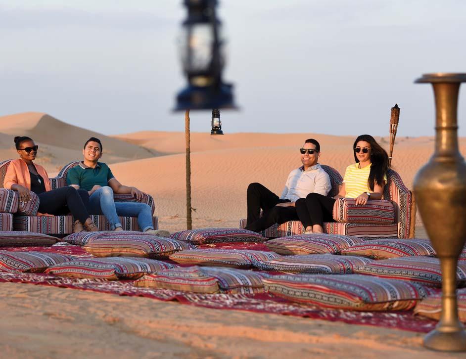 people at desert safari in Dubai sunset