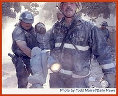 9-11-01 Photo a Cop FF Carrying Inj Man_