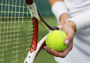Woman holding tennis racket and ball Gen