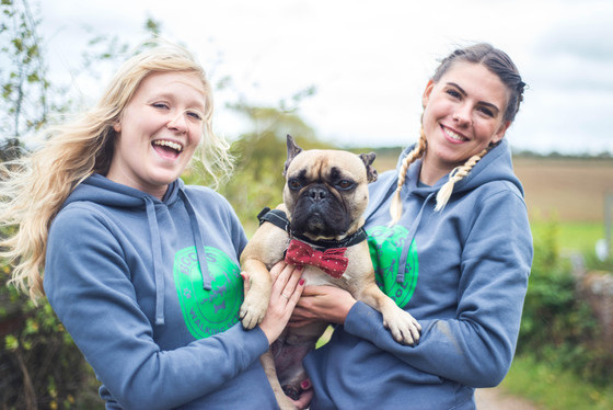 Our logo designs come to life on dog walkers uniforms