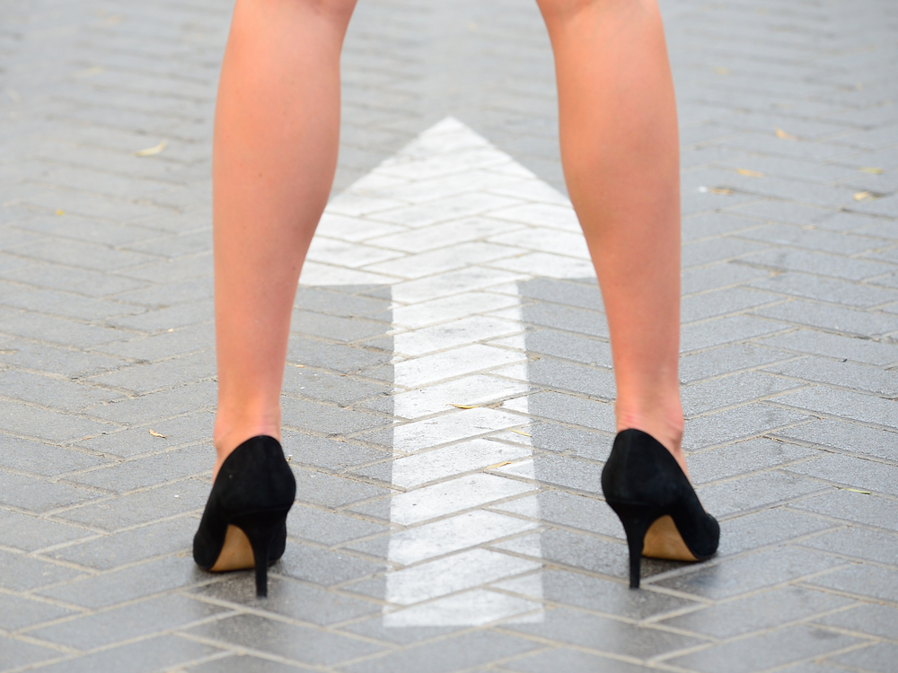 Woman in heels stepping into power