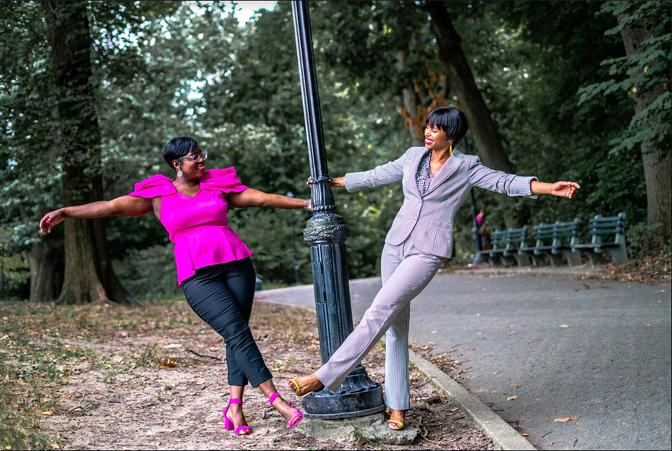 Dionne & Elicia Swinging on  Lamp Post.p