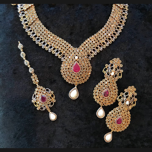 Sanya Polki Ruby and Pearl necklace, Earrings, and Tika