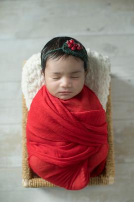 newborngirlinred.jpg