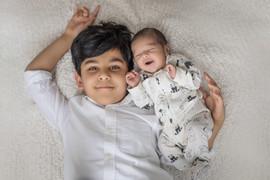 newbornwithsibling.jpg