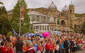 Parading gigante puppets during the Olympic Torch Relay Parade in 2012 on its way through Buxton, Derbyshire