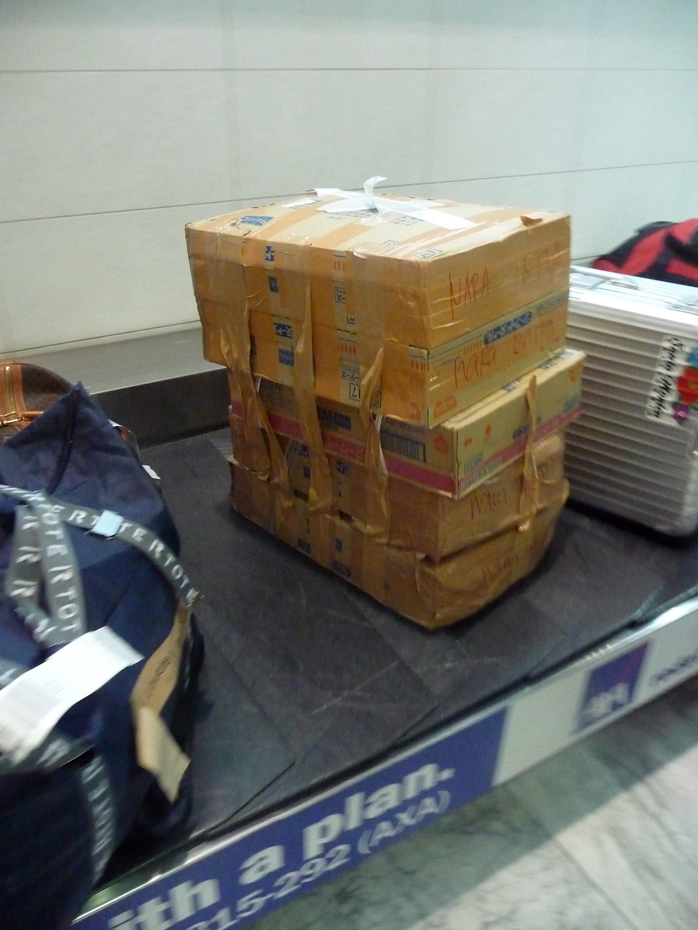 Battered box on baggage carousel