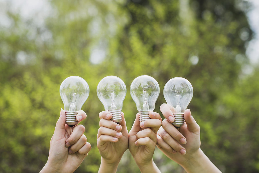 eco-concept-with-hands-holding-light-bul