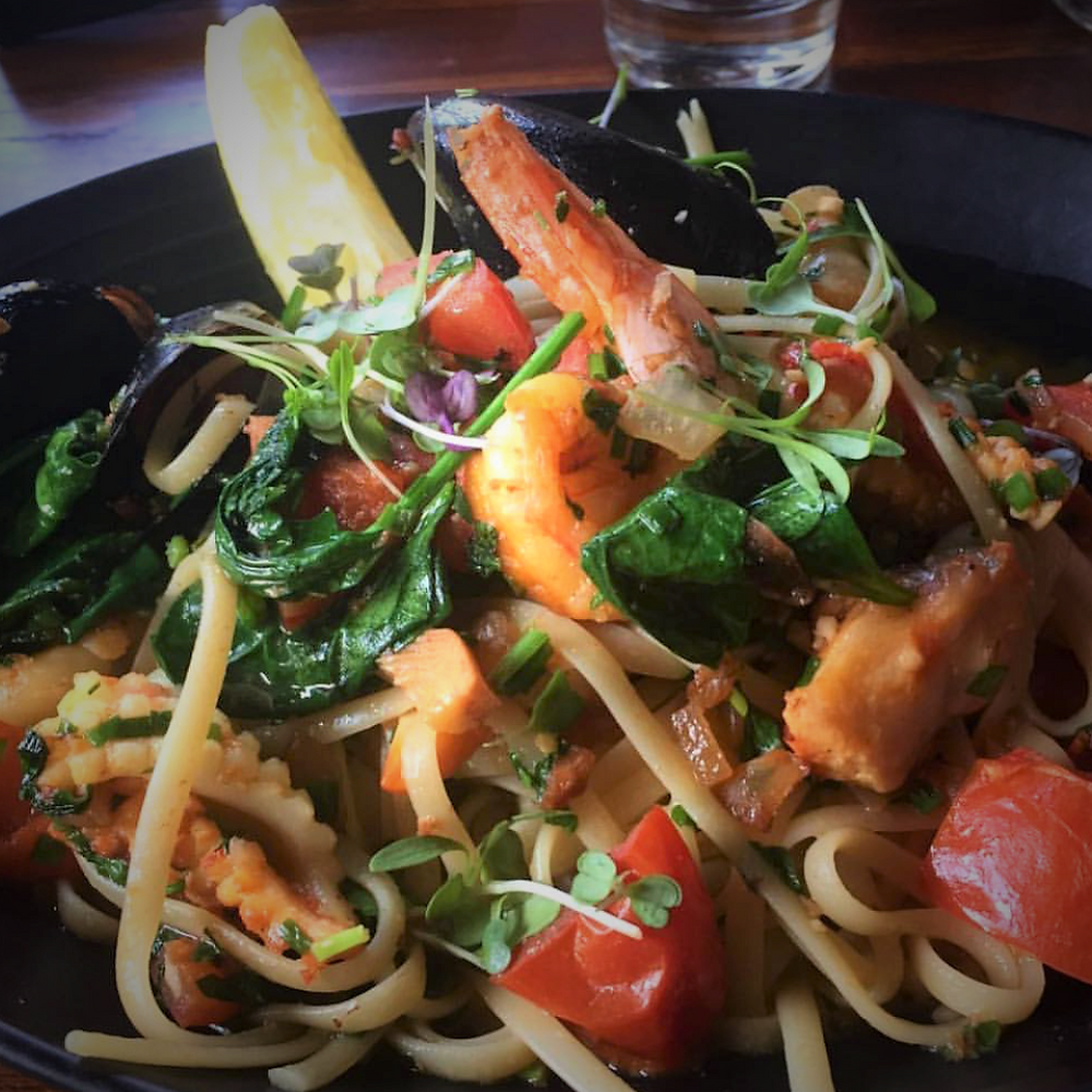 SEAFOOD LINGUINE (Gluten Free Option available) - Prawns, calamari, fish, black mussels,  tomato, garlic, chilli and spinach in a pernod, white wine and olive oil reduction