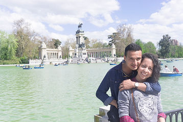 Two bartenders enjoy a trip to Madrid in a park. Marriage couple ready to serve beer, wine, alcohol to guests at weddings, parties, private events