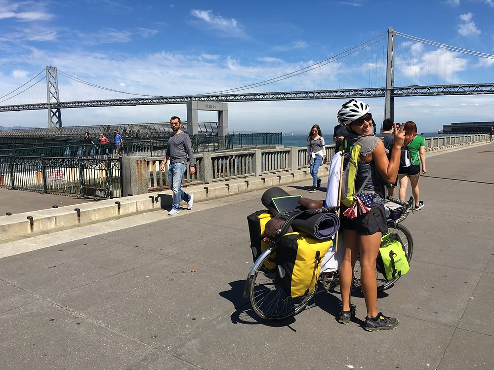 She made it! Maggie poses triumphantly at the San Fran Coast!