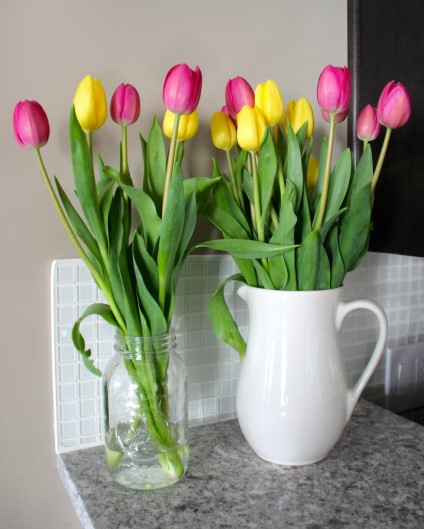 Nothing says spring like tulips. Beautiful flowers add colour to any room in your house. Add a country feel by using a big mason jar or a water pitcher (like this one for $8.99 from Ikea) instead of your traditional vase.