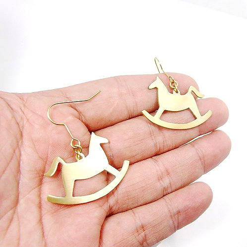 Rocking horse earring in brass
