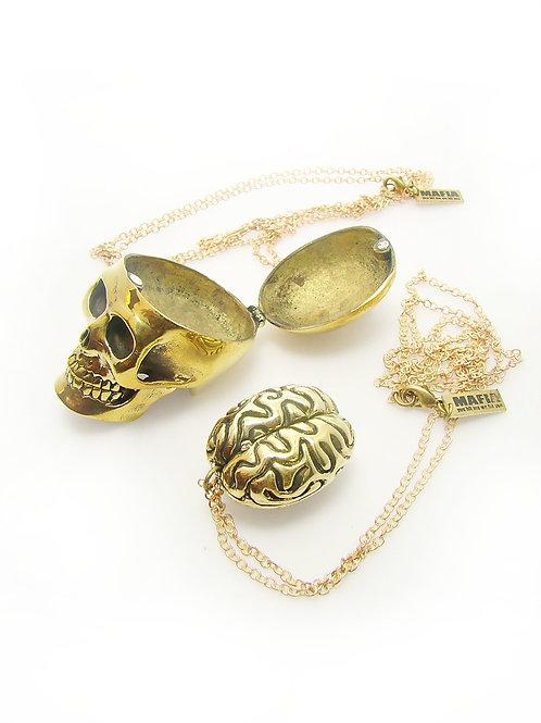Skull with brain pendant in brass