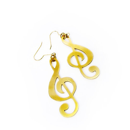 G clef earring in brass hand sawing