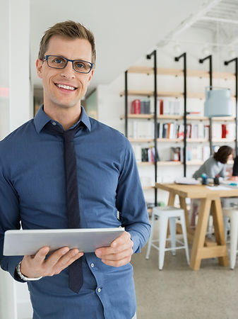 Professional Man Holding a Tablet