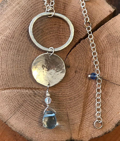 Sterling silver hammered necklace with blue topaz