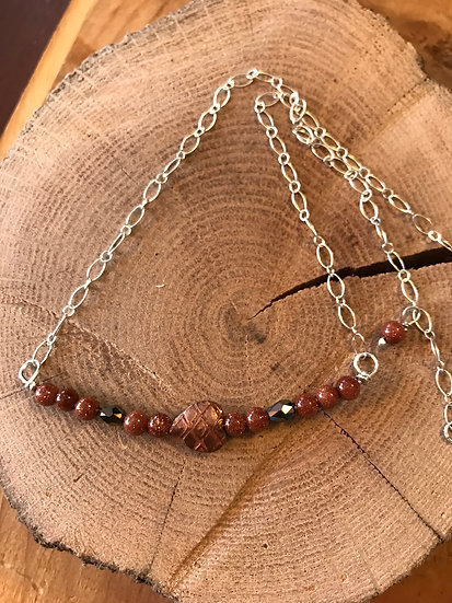 Sterling silver necklace with goldstone crystals