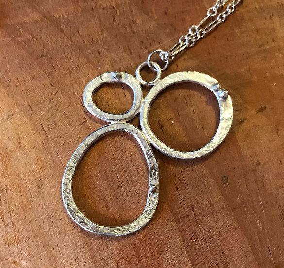 Sterling silver hammered triple hoops