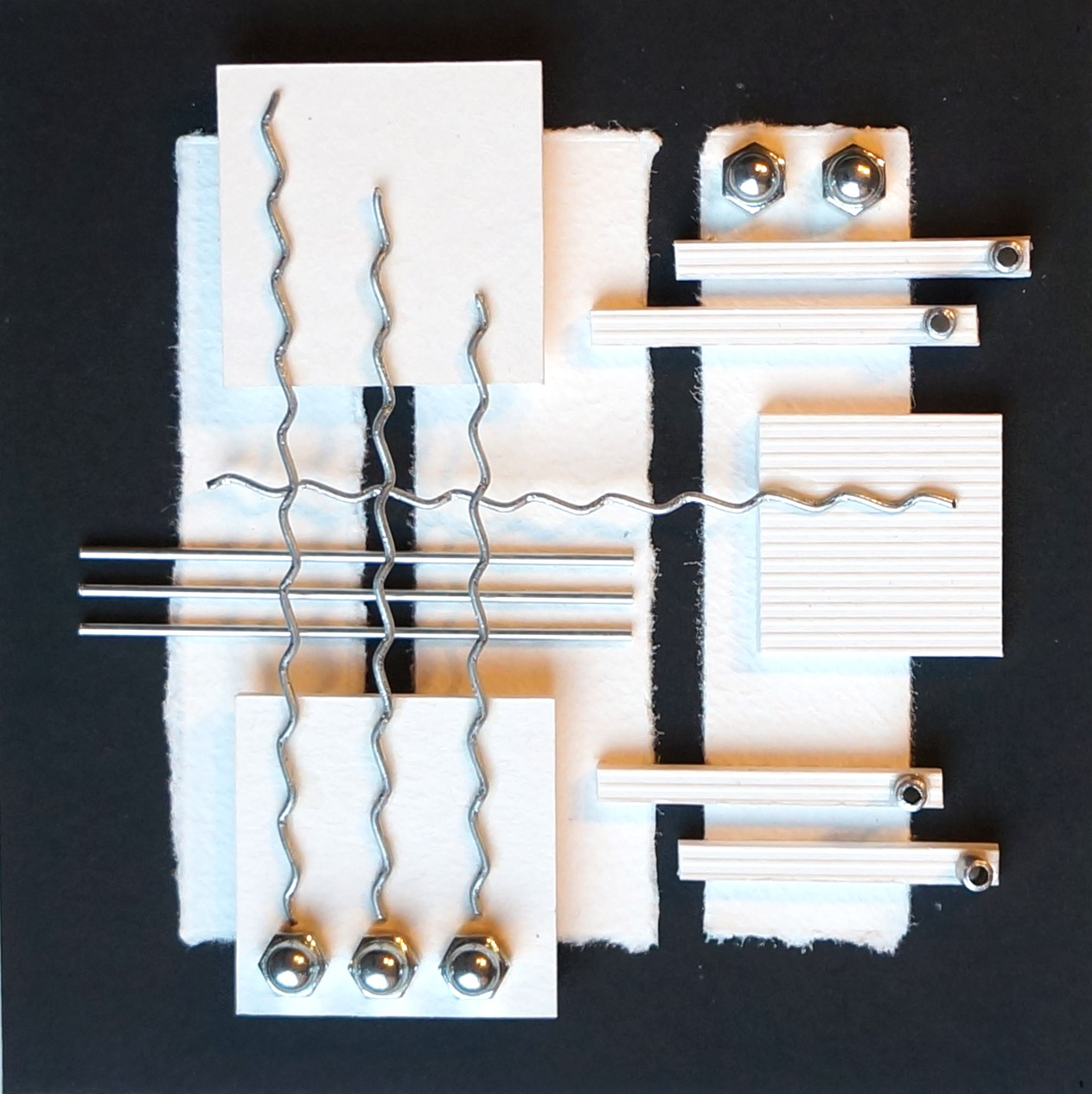 card and metal assemblage  15 x 15cm