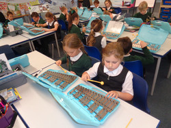 Year 3 children learning to play the c a