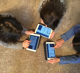 Three Young Kids in a circle on ipads
