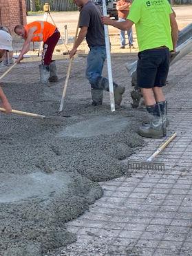 Hardworking Crew Spreading the Cement