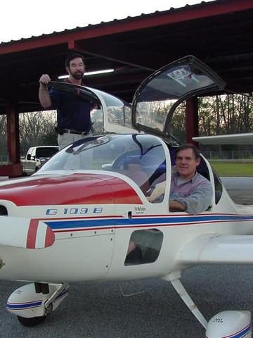 Pat and Raymond in plane.JPG