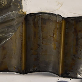 Unwrapped battery showing anode after failure