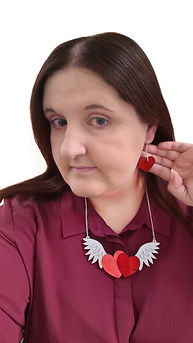 Gina wearing PinkRed Winged Hearts Neckl