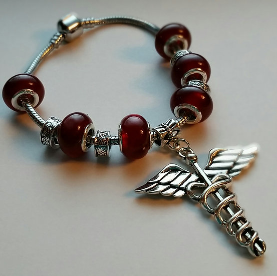 Beaded Bracelet with Dental Symbol Charm