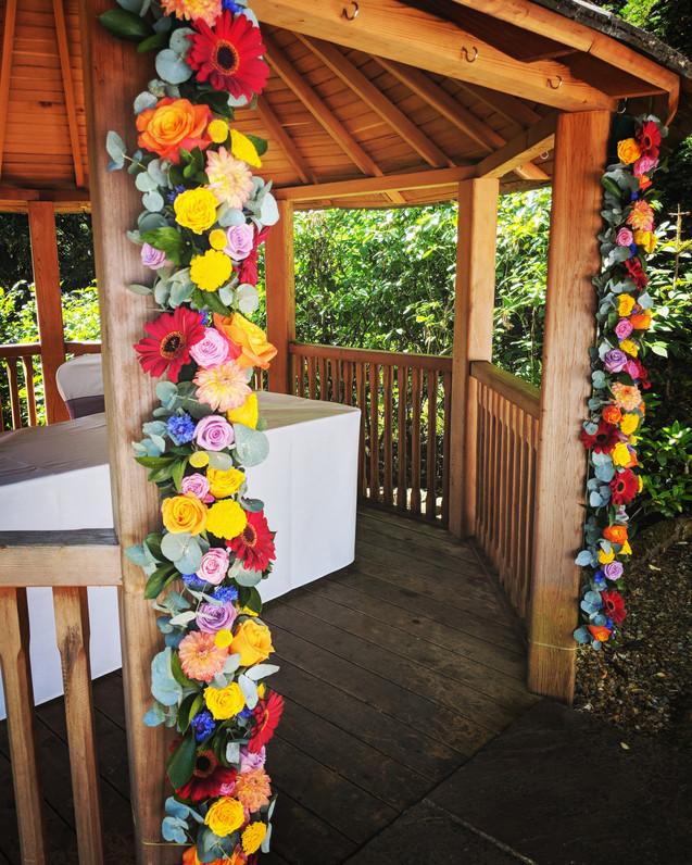 Bright & bold flower arch.jpg