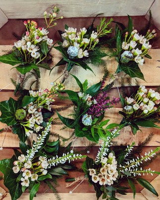 Waxflower and heather buttonohles.jpg