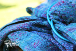 Woven cloth with blue sling rings