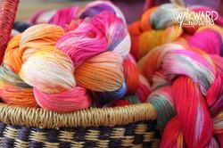 Dyed warp chains, in basket
