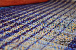 Woven cloth, gold tail accents
