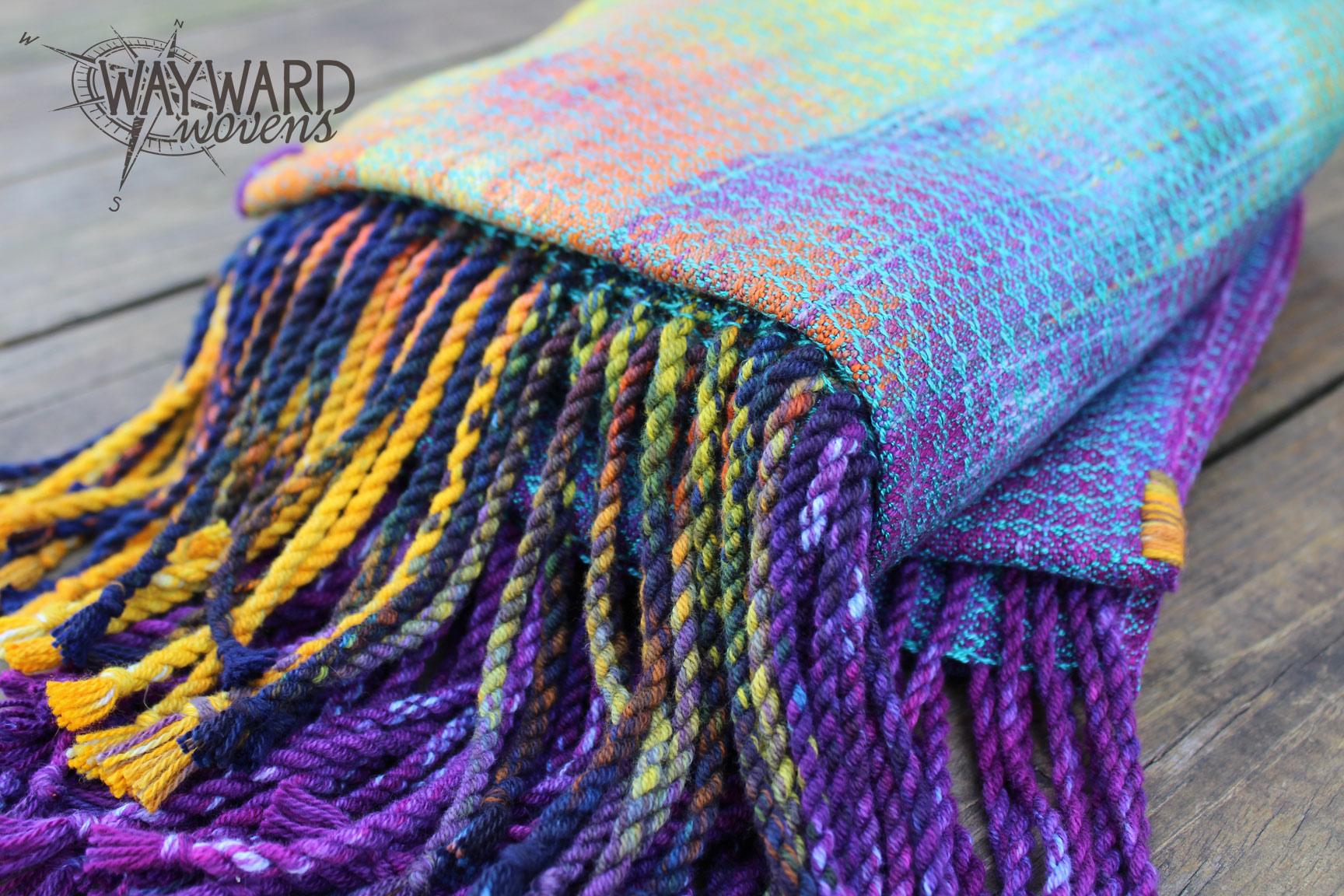 Fringed woven wrap, folded